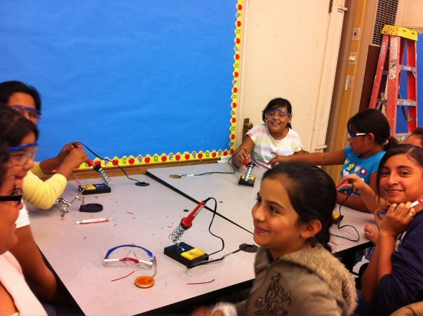 Girls from Telfair Elementary School in Pacoima work on inventing some arcade games for the upcoming showcase on Friday, June 14, 2013.